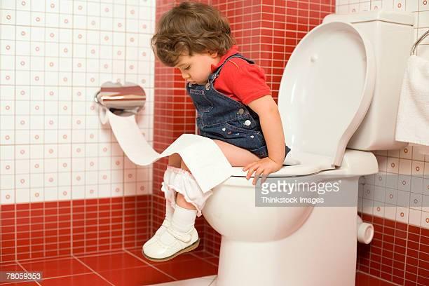 Girl using toilet