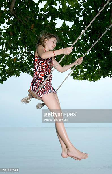 Girl Using Tree Swing at Beach