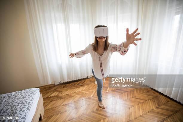 Girl using virtual headset