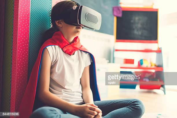 Girl Using Virtual Reality Glasses In Her Room.