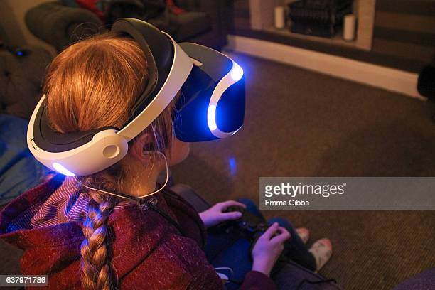 Girl using VR headset at home