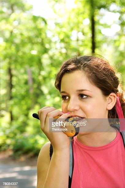 Girl using walkie-talkie outdoors