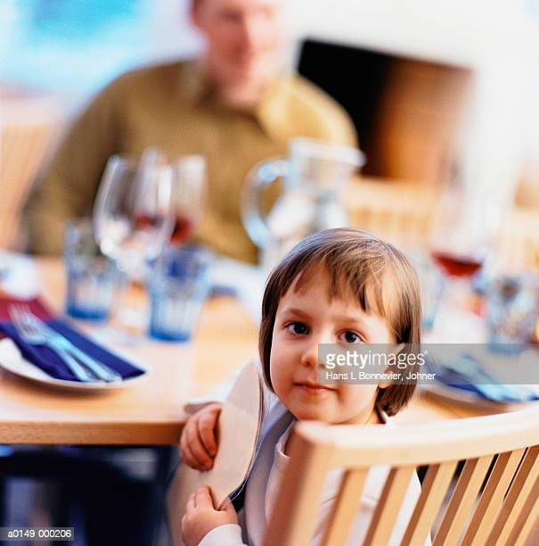 Girl Waiting at Dinner Table