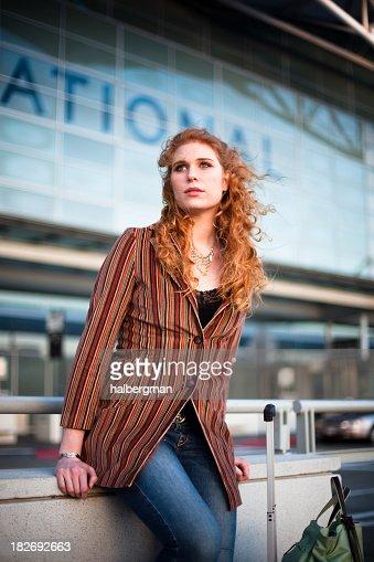 Girl waiting at the Airport