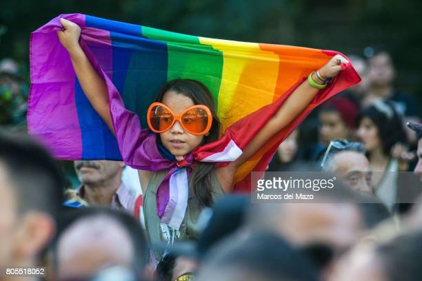 A girl waiving a rainbow flag during the demonstration of the WorldPride 2017