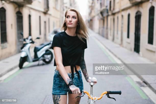 Girl Walking a Bicycle