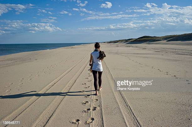 Girl walking along beach