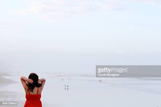 Girl Walking along Shore