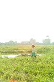 Girl walking along the river