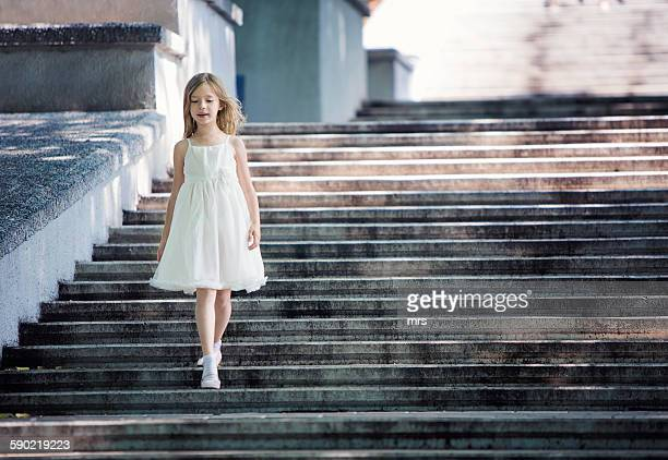 Girl walking down stairs