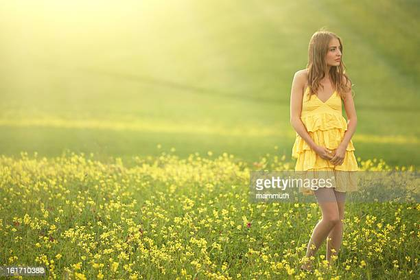 girl walking in a flower covered field