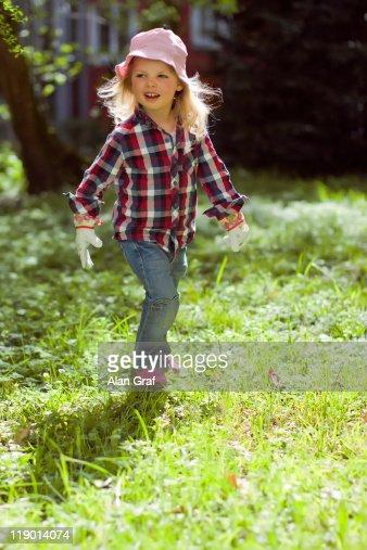 Girl walking in backyard : Stock Photo