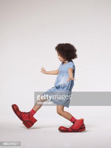 Girl walking in large clown shoes