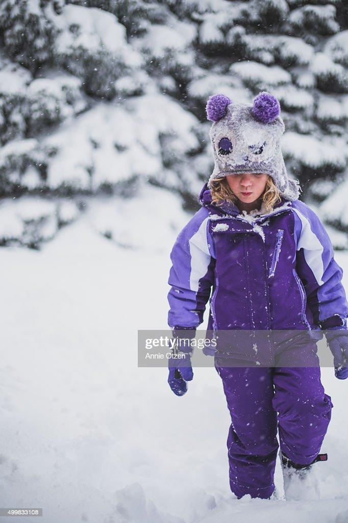 Girl Walking in Snow