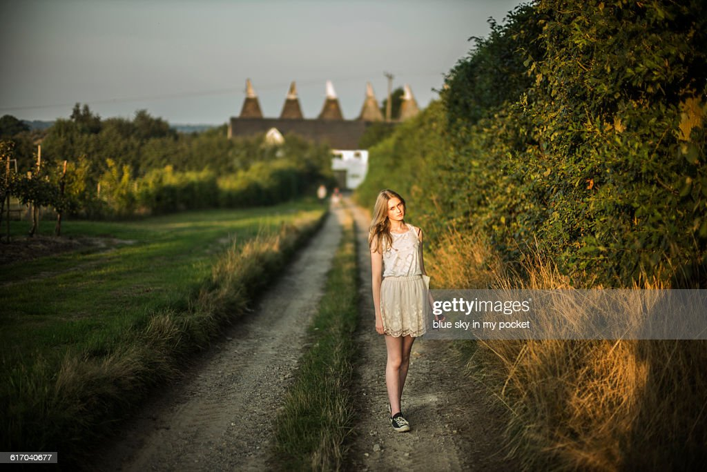 Girl walking in the countryside. : Stock Photo