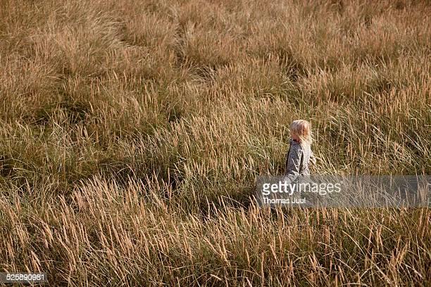 Girl walking in the dunes