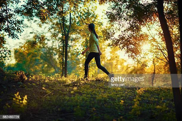 Girl walking in the sunset