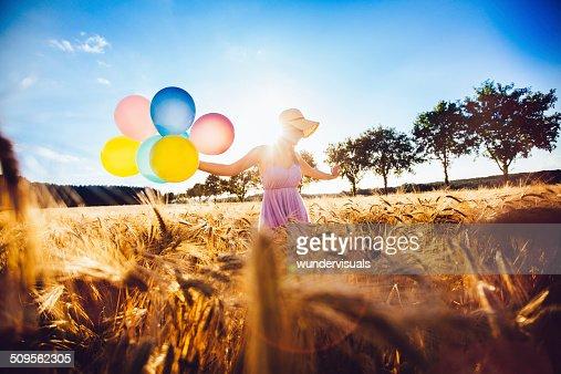 Girl Walking in Wheat Field