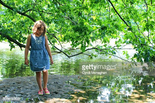 Girl Walking Next to Lake : Foto de stock