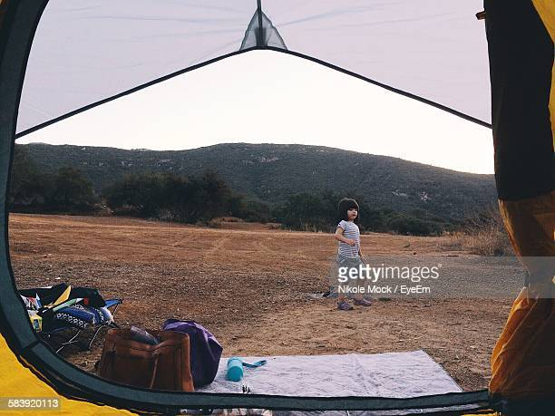 Girl Walking On Field Seen Through Tent At La Jolla Indians Campground