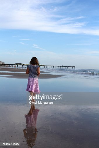 Girl Walking on Sand : Stock Photo