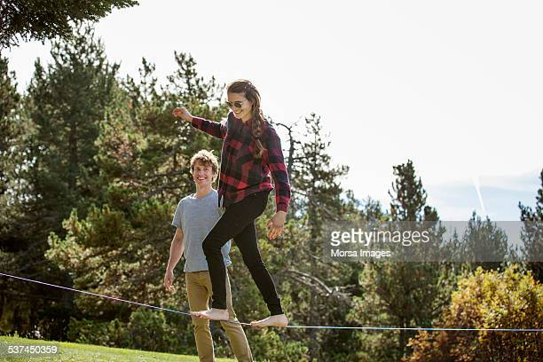 Girl walking on slack-line