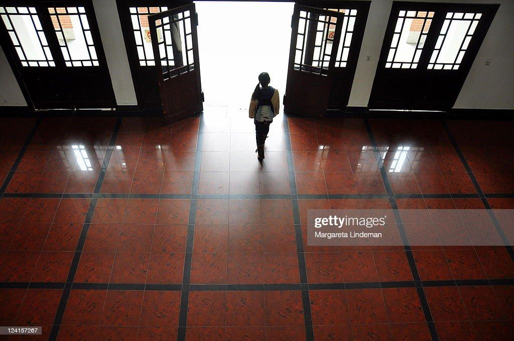 Girl Walks Into Door : Girl walking through door into light stock photo getty