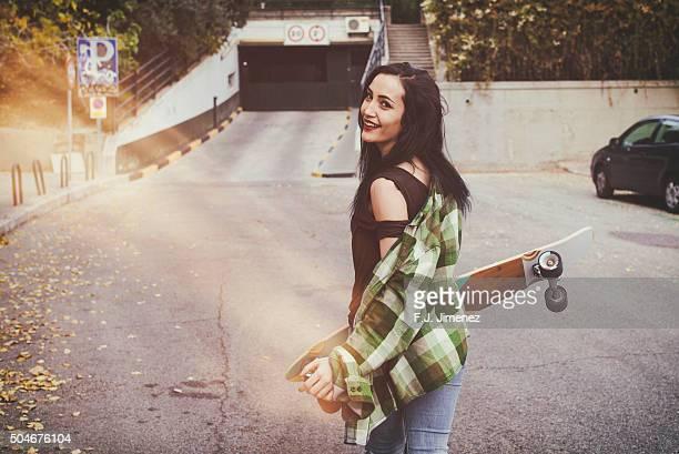 Girl walking with longboard