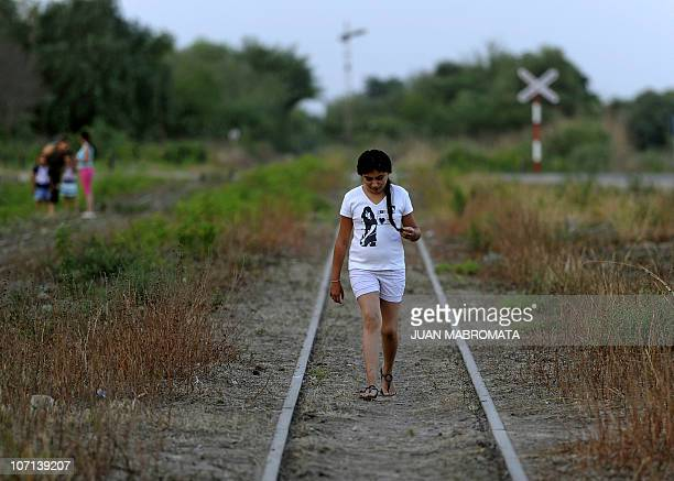 LASKI A girl walks along the railroad tracks towards the Children's Hospital Train during medical and odontology controls for the local children of...