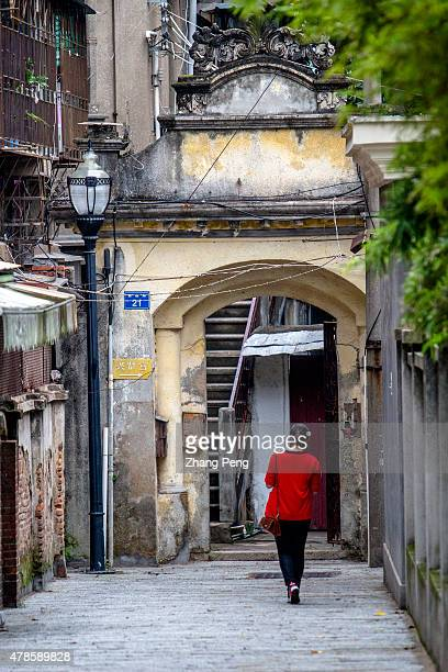 A girl walks back to a family hotel renovated from a historical building Kulangsu is an island off the coast of Amoy city After the First Opium War...
