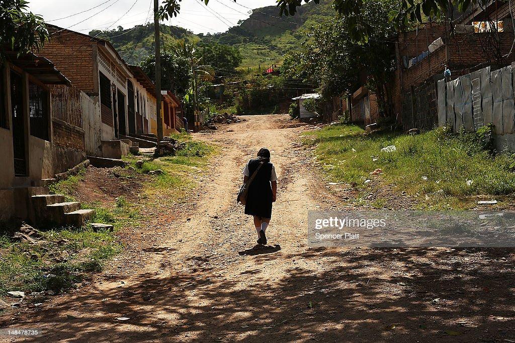 A girl walks home in a gang infested neighborhood on July 17 2012 in Tegucigalpa Honduras Honduras now has the highest per capita murder rate in the...