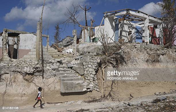 TOPSHOT A girl walks in Port Salut Haiti on October 12 following the passage of Hurricane Matthew A week after Matthew tore through the country many...