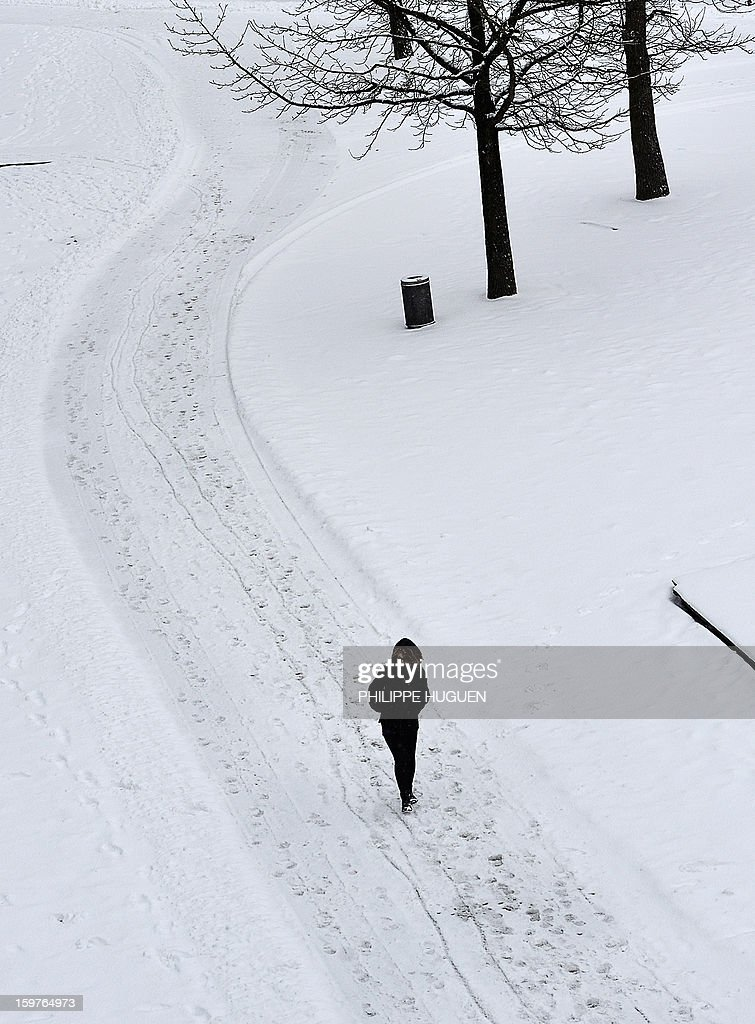 A girl walks in the snow on January 20, 2013 in Lille. HUGUEN