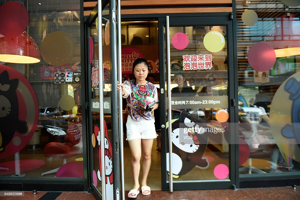 A girl walks out of a Hello Kitty theme restaurant on June 29, 2016 in Hangzhou, Zhejiang Province of China. A Hello Kitty theme restaurant was authorized opened firstly in Hangzhou.