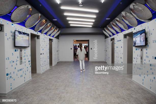 A girl walks past elevators at the Facebook Inc Hack Station in Sao Paulo Brazil on Monday Dec 11 2017 The Facebook Hack Station is the first of the...