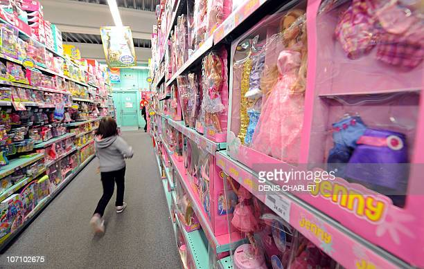 A girl walks past the shelves of La Grande Recre toys departement store in the French northern city of BruaylaBuissiere on November 20 2010 As...