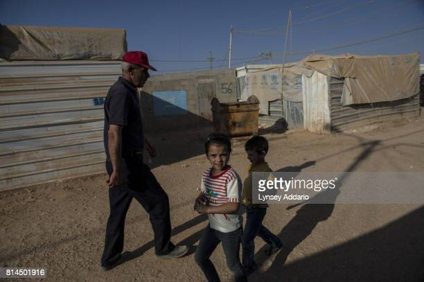 A girl walks though Zaatari camp in Mafraq Province Jordan September 14 2013 There are roughly 120000 Syrian refugees living in the Zaatari camp and...