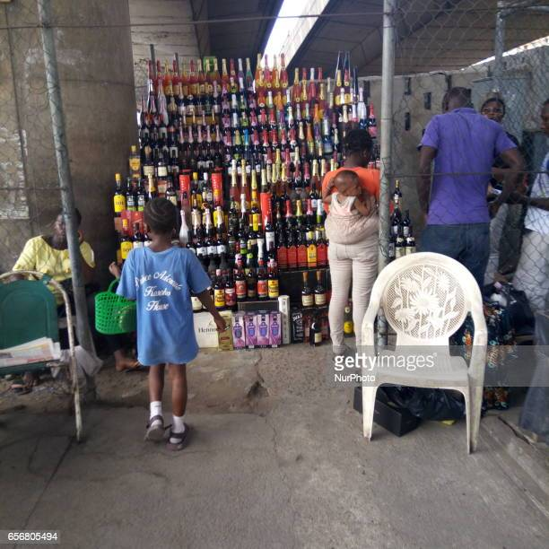 A girl walks toward a wine seller under Apongbon bridge in Lagos Nigeria on Wednesday March 22 2017 Nigeria currency naira hits six month high...