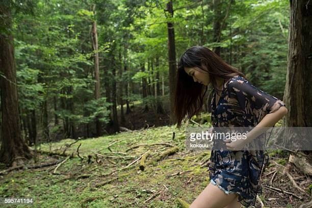 Girl wandering in the forest.