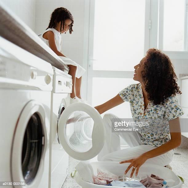 Girl Watches Mum Doing Laundry