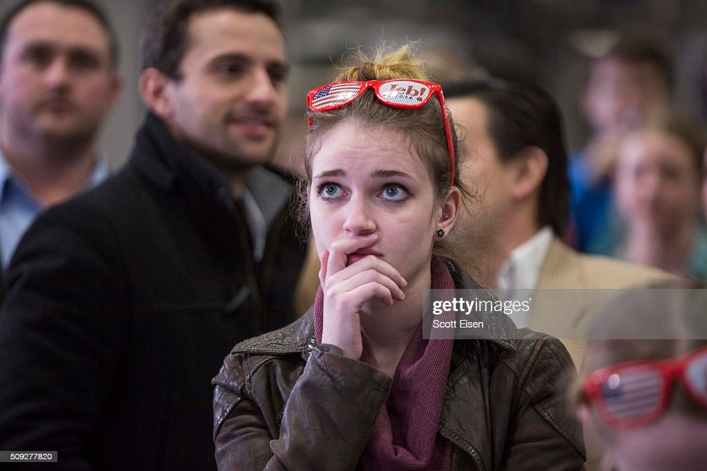A girl watches poll numbers on a big screen at Republican presidential candidate Jeb Bush's election night party at Manchester Community College on...