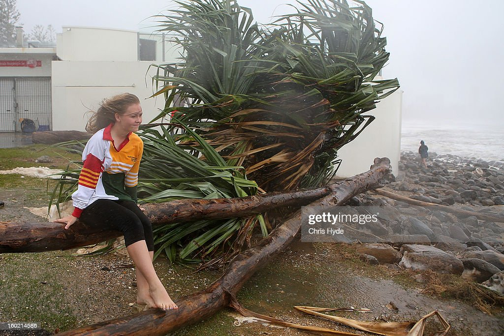 A girl watches the wild weather in Burleigh Heads as Queensland experiences severe rains and flooding from Tropical Cyclone Oswald on January 28, 2013 in Gold Coast, Australia. Hundreds have been evacuated from the towns of Gladstone and Bunderberg while the rest of Queensland braces for more flooding.