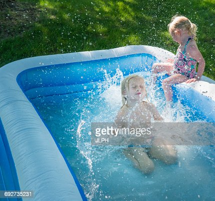 Big brother big sister stock photos and pictures getty for Biggest paddling pool