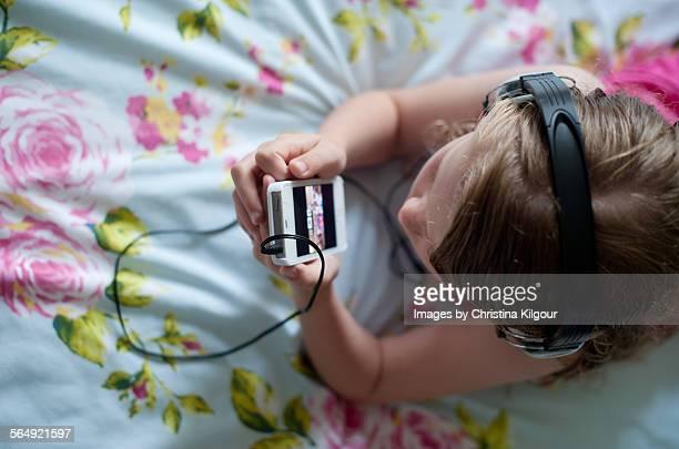 Girl watching her smartphone