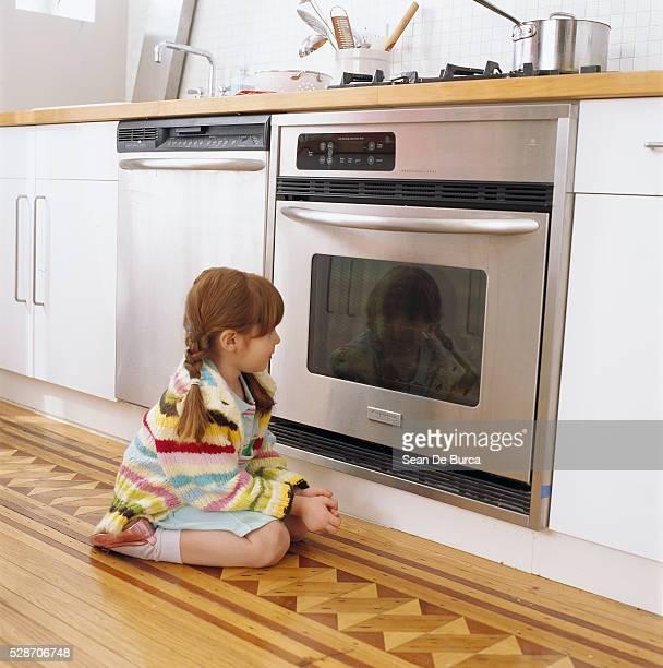 Girl Watching Oven Window
