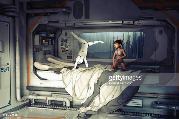 Girl watching robot do handstand on futuristic bed