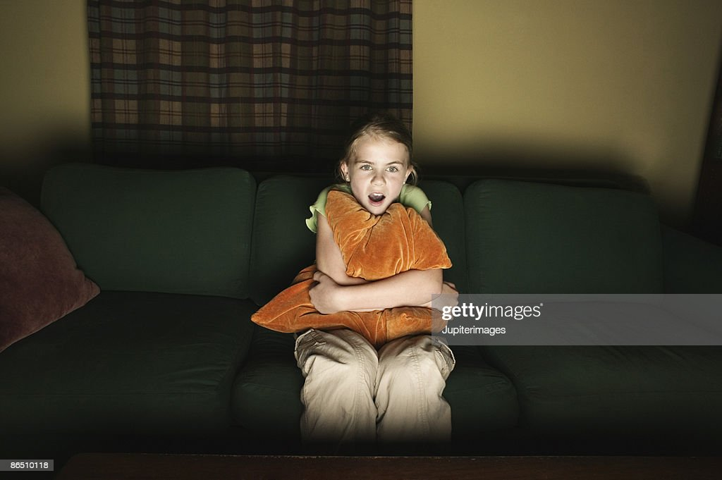 Girl watching television : Stock Photo