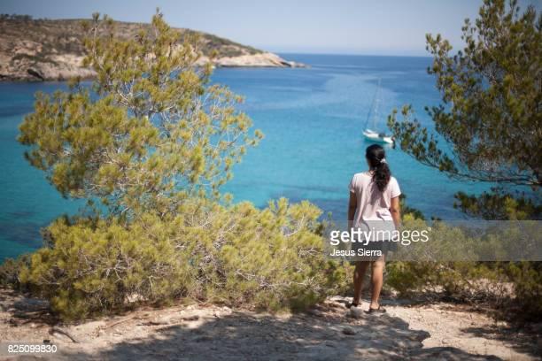 Girl watching the mediterranean sea in Ibiza