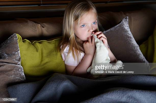 Girl watching tv with her blanket