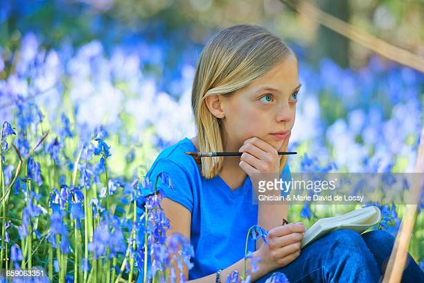 Girl watercolour painting in bluebell forest, Hallerbos, Brussels, Belgium